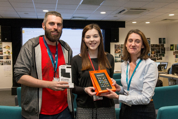 Jessica Burnhope receives the Kindle Fire from Judith Quinn (Assistant Principal VI Forms & Higher Education) with Next Gen Lecturer Matthew McGrory in attendance.